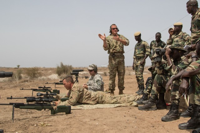 U.S. Army Master Sgt. Mac Broich an instructor with the Vermont National Guard's Reginonal Training institute instructs  Senegalese soldiers at a advanced marksmenship range  July 17, 2016 in Thies, Senegal as part of Africa Readiness Training 16. ART16 is a U.S. Army Africa exercise designed to increase U.S. and Senegalese readiness and partnership through combined infantry training and live fire events. (US Army photo by Spc. Craig Philbrick)