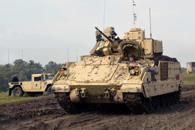 A Soldier with 3rd Battalion, 116th Cavalry Brigade Combat Team drives a Bradley Fighting Vehicle that was shipped from the U.S. during training in Cincu, Romania, July 30. Saber Guardian 2016 is a multinational military exercise involving approximately 2,800 military personnel from ten nations including Armenia, Azerbaijan, Bulgaria, Canada, Georgia, Moldova, Poland, Romania, Ukraine and the U.S. The objectives of this exercise are to build multinational, regional and joint partnership capacity by enhancing military relationships, exchanging professional experiences, and improving interoperability between the land forces from the participating countries.