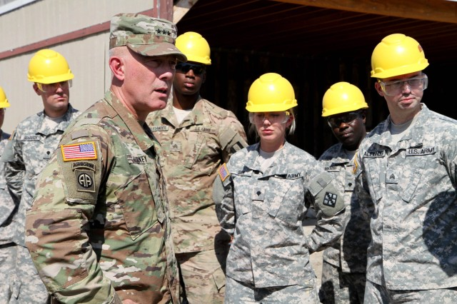 More than a dozen students and instructors from the second phase of the 80th Training Command's carpentry and masonry specialist course met with Lieutenant General Charles D. Luckey, the commanding general of the United States Army Reserve, for an impromptu Q& A session at Tactical Training Center-Fort Dix, N.J. July 16, 2016. With numerous courses taught over a twelve month period, instructors at TTC Dix train about 150 soldiers every calendar year in construction, carpentry and masonry, electrical engineering, and plumbing.