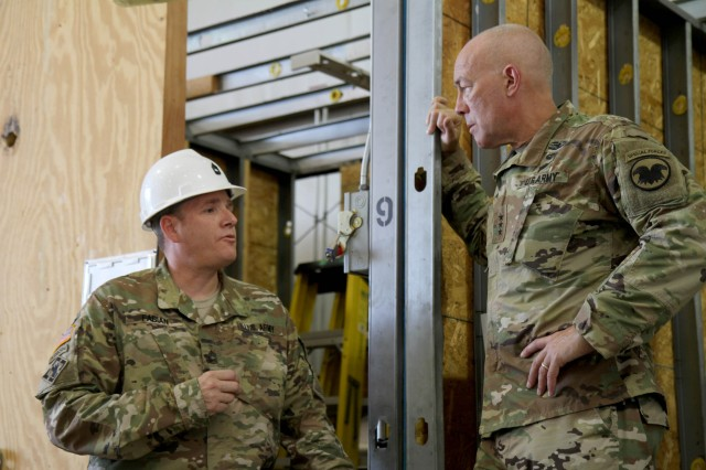 Master Sgt. Christopher Fabian, course manager for Tactical Training Center Dix, gives Lieutenant General Charles D. Luckey, commanding general of the U.S. Army Reserve, a brief run-down of his classroom's capabilities, including the training booth which allows students to gain practical experience in everything from basic plumbing to electrical wiring installation. Luckey met with more than a dozen students and instructors from the second phase of the 80th Training Command's carpentry and masonry specialist course during Luckey's visit to Fort Dix, N.J. July 16, 2016.
