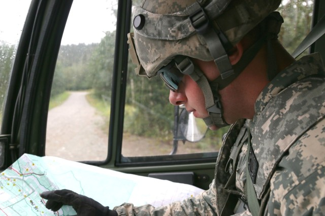 Spc. Anthony Dreeszen, a motor transport operator with D Company, 334th Brigade Support Battalion, Iowa Army National Guard, finds a supply drop-off location on a map at Donnelly Training Area, Delta Junction, Alaska, July 22, 2016. Logistics runs such as the one Dreeszen went on were extremely vital to mission success during Operation Arctic Anvil.