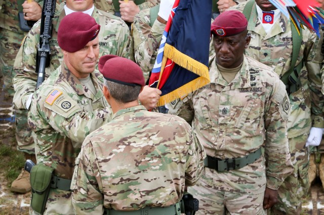 Lt. Gen. Stephen J. Townsend (center) commander of XVIII Airborne Corps, passes the unit guidon to Maj. Gen. Erik Kurilla (left) commander of 82nd Airborne Division, during the Division change of command ceremony at Pike Field, Fort Bragg, N.C., Aug. 2nd, 2016. The ceremony marked the end of Maj. Gen. Richard Clarke's, and the beginning of Maj. Gen. Erik Kurilla's, command of the 82nd Airborne Division. Clarke will continue to serve the Army as the vice director of strategic plans and policy for the Joint Staff at the Pentagon. (U.S. Army photo by Sgt. Juan F. Jimenez)