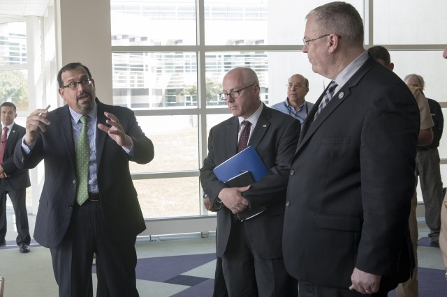 U.S. Army Research Laboratory acting Director Dr. Philip Perconti (left) explains the lab's additive manufacturing initiatives to DOD officials.