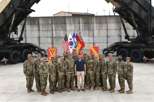 The Secretary of the Army, Mr. Eric Fanning, smiles with Soldiers assigned to 35th Air Defense Artillery Brigade and Republic of Korea -- Army at Osan Air Base, Aug. 2. Fanning toured the D Battery, 6-52 ADA Battalion Patriot site as part of his 12-day Pacific Rim tour. His visit to 35th ADA included a reload drill, air battle management inside an engagement control station, and an interview with local media.