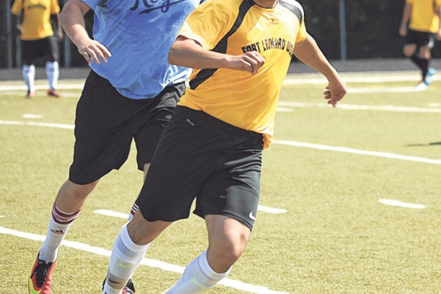 FLW United defender Manny Sanchez clears the ball after an attack by the UCM club team Saturday during the Whiteman Air Force Base Invitational Tournament at Knob Knoster, Mo.
