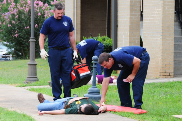 Emergency responders arrive on the scene to render aid to simulated victims during last year's all-hazards force protection exercise. This year's exercise is scheduled for Aug. 10.