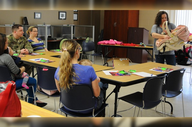 Katrina Blaylock, child passenger safety technician, gives a course on car seat safety at The Commons earlier this year as a part of the new parent support program.