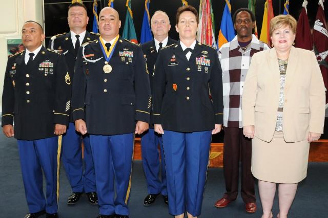 Back row: Sgt. Maj. Thomas V. Snura, Lt. Col. William H. Taylor and Elbert Williams. Front row: Staff Sgt. Mike L. Gomez, Sgt. 1st Class Keith E. Brittin, Sgt. 1st Class Vicki L. Wood, Carol Ann Boylston-Lee.