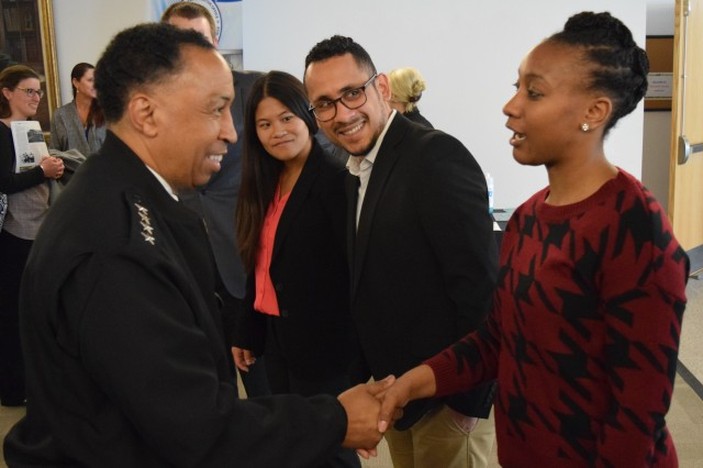 U.S. Army Materiel Command Commander Gen. Dennis L. Via shakes hands with Army interns from AMC major subordinate commands at Aberdeen Proving Ground, Maryland, during Army Innovation Summit 2, held in April 2016. (Photo Credit: Army Materiel Command)