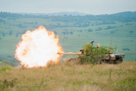 Soldiers with Delta Company, 3rd Battalion, 116th Cavalry Brigade Combat Team, conduct a live fire exercise in an M1A2 Abrams Tank during Exercise Saber Guardian 16 at the Romanian Land Force Combat Training Center in Cincu, Romania, Aug. 2. Saber Guardian is a multinational military exercise involving approximately 2,800 military personnel from ten nations including Armenia, Azerbaijan, Bulgaria, Canada, Georgia, Moldova, Poland, Romania, Ukraine and the U.S. The exercise is designed to build multinational, regional and joint partnership capacity by enhancing military relationships, exchanging professional experiences, and improving interoperability between the land forces from the participating countries.