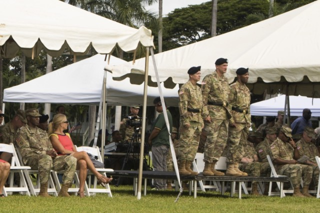 JOINT BASE PEARL HARBOR-HICKAM, Hawaii-U.S. Army Brig. Gen. Eric L. Sanchez (left), the outgoing 94th Army Air and Missile Defense Command's commander, Gen. Robert B. Brown (center), the commander of the U.S. Army Pacific, and Brig. Gen. Sean A. Gainey (right), the incoming 94th AAMDC commander, prepare to step down onto the historic Palm Circle lawn, during a change of command ceremony, Aug. 5, 2016 at Fort Shafter, Hawaii. (U.S. Army photo by Sgt. Kimberly K. Menzies, 94th Army Air and Missile Defense Command Public Affairs)