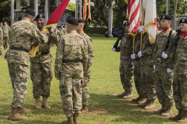 JOINT BASE PEARL HARBOR-HICKAM, Hawaii-U.S. Army Brig. Gen. Sean A. Gainey, the new commander of the 94th Army Air and Missile Defense Command, accepts the unit's colors from Gen. Robert B. Brown, the commander of the U.S. Army Pacific, during a change of command ceremony, Aug. 5, 2016 at historic Palm Circle on Fort Shafter, Hawaii. The passing of the colors represents the trust and confidence in the new commander's leadership and commitment to care for the organization's colors and what they represent.  (U.S. Army photo by Sgt. Kimberly K. Menzies, 94th Army Air and Missile Defense Command Public Affairs)