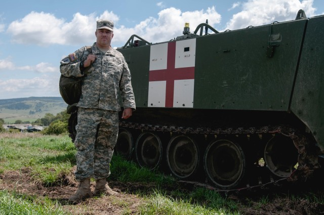 Staff Sgt. Brad Foster, a combat medic with the Oregon Army National Guard's Headquarters and Headquarters Company, 3rd Battalion, 116th Heavy Brigade Combat Team from Pendleton, Ore., is deployed to the Romanian Land Forces Combat Training Center in Cincu, Romania, for Exercise Saber Guardian 16, Aug. 3, 2016.