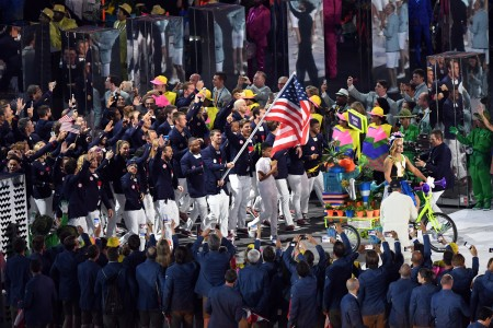 Twenty-two time Olympic medalist swimmer Michael Phelps carries the Stars and Stripes while leading Team USA into Maracanã Stadium during the Opening Ceremony of the 2016 Olympic Games in Rio de Janeiro, Brazil, Aug. 5, 2016.