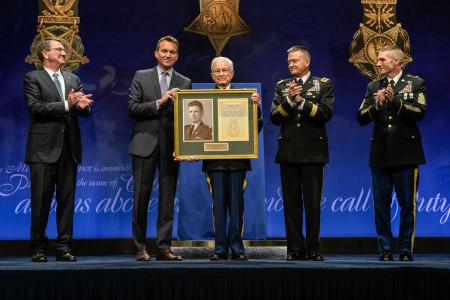 Secretary of Defense Ashton Carter, Secretary of the Army Eric Fanning, Vice Chief of Staff Gen. Daniel Allyn and Sgt. Maj. of the Army Daniel Dailey present a framed Medal of Honor citation to retired Lt. Col. Charles Kettles during the Hall of Heroes Induction Ceremony at the Pentagon, in Arlington, Va., July 19, 2016, for actions during a battle near Duc Pho, South Vietnam, May 15, 1967.