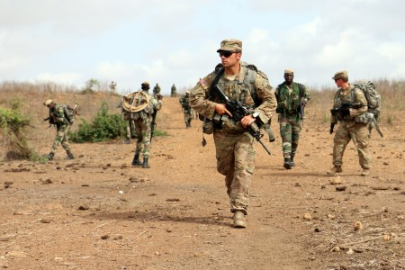 1st Lt. Patrick Wilver (center), mortar platoon leader with 1st Battalion, 30th Infantry Regiment, 2nd Infantry Brigade Combat Team, 3rd Infantry Division, patrols with his platoon and Senegalese soldiers of 1st Paratrooper Battalion, July 22, 2016 in Thies, Senegal as part of Africa Readiness Training 16. ART16 is a U.S. Army Africa exercise designed to increase U.S. and Senegalese readiness and partnership through combined infantry training and live-fire events.