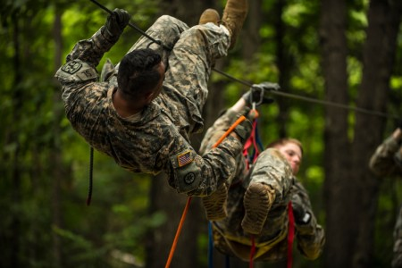 Cadets in Cadet Basic Training at Fort Knox, Ky., attempt to evacuate a simulated casualty across an obstacle at the Leaders Reaction Course, July 23.