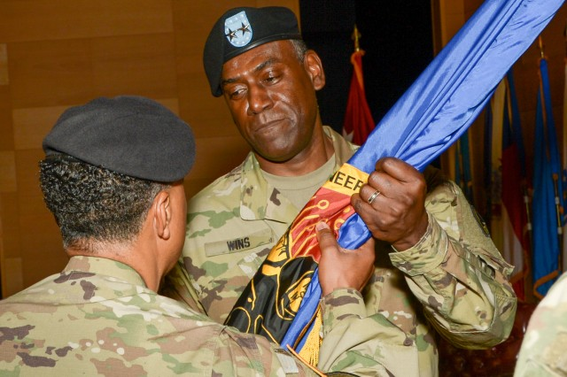 Gen. Dennis L. Via (left) presents the U.S. Army Research, Development and Engineering Command colors to Maj. Gen. Cedric T. Wins during a change of command ceremony Aug. 9, 2016, at Aberdeen Proving Ground, Maryland.