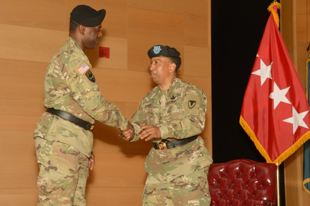 Gen. Dennis L. Via (right) and Maj. Gen. Cedric T. Wins shake hands during the U.S. Army Research, Development and Engineering Command change-of-command ceremony Aug. 9, 2016, at Aberdeen Proving Ground, Maryland.