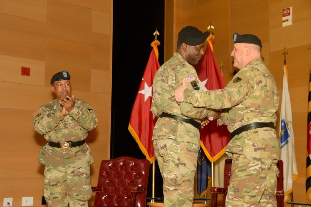 Maj. Gen. Cedric T. Wins (left) and Maj. Gen. John F. Wharton shake hands during the U.S. Army Research, Development and Engineering Command change-of-command ceremony Aug. 9, 2016, at Aberdeen Proving Ground, Maryland.