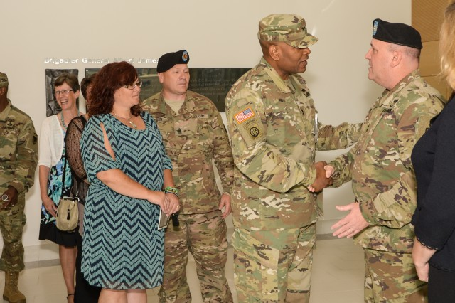 Maj. Gen. John F. Wharton greets fellow Soldiers and friends after the U.S. Army Research, Development and Engineering Command change-of-command ceremony Aug. 9, 2016, at Aberdeen Proving Ground, Maryland.