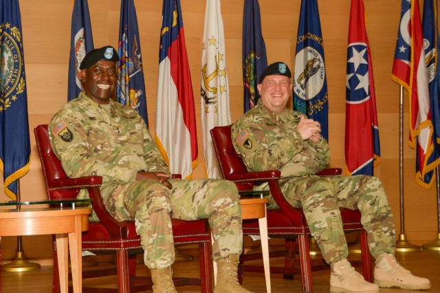 Maj. Gen. Cedric T. Wins (left) and Maj. Gen. John F. Wharton share a laugh as Gen. Dennis L. Via speaks during the U.S. Army Research, Development and Engineering Command change-of-command ceremony Aug. 9, 2016, at Aberdeen Proving Ground, Maryland.