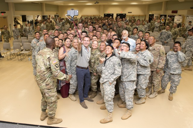 Secretary of the Army Eric Fanning, center, snaps a selfie photo with 400 Active Duty, National Guard and Reserve Soldiers as well as Department of the Army Civilians at the Guam National Guard Joint Forces Headquarters during a townhall on Friday, July 29.