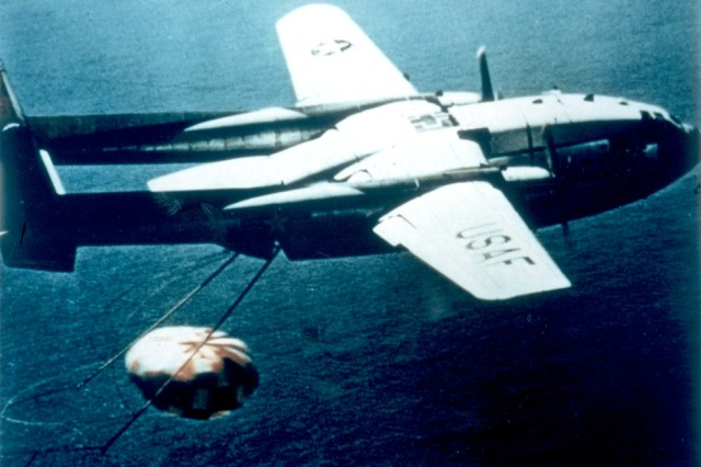 Undated image of an Air Force C-119 recovering a Corona film canister as it returns to Earth from space.