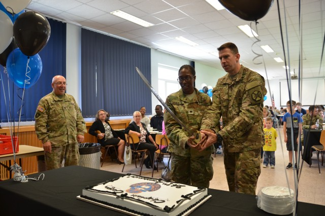 Spec. Jocelyn Johnson, USAG Ansbach chaplain assistant, and Col. Benjamin C. Jones, USAG Ansbach garrison commander, cut the cake after the ceremony for the Chaplain Corps Anniversary Aug. 11, 2016 (U.S. Army photo: Bianca Sowders)
