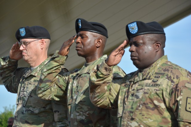 Col. James Groark, outgoing acting Chief of Ordnance; Maj. Gen. Darrell K. Williams, CASCOM and Fort Lee commanding general; and Col. David Wilson, incoming Chief of Ordnance, salute while the national colors pass during the Ordnance Corps assumption of command ceremony Aug. 10 at Whittington Parade Field.