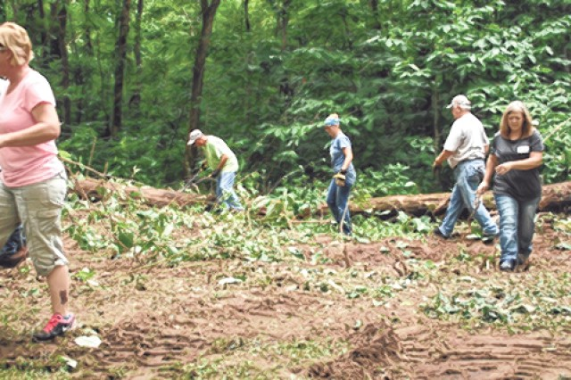 A team of three post directorates teamed up to clean Happy Hollow Park Friday. Photo by Caitlyn Marler/FMWR Marketing