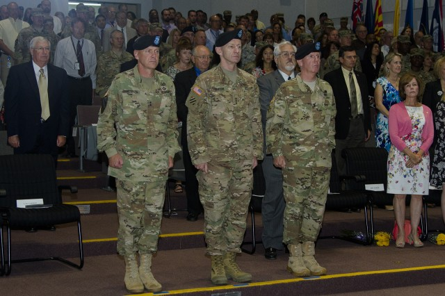 Maj. Gen. John B. Morrison Jr., outgoing commander, Lt. Gen. Edward C. Cardon, commanding general of Army Cyber Command and Second Army, and Maj. Gen. John W. Baker, incoming commander, prepare to conduct a change of command ceremony August 10, at Greely Hall at Fort Huachuca, Arizona.