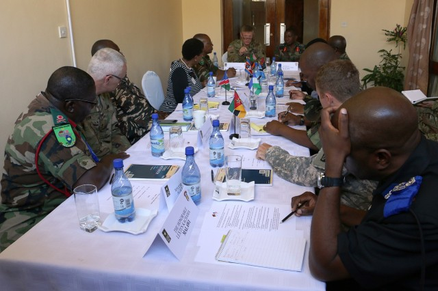 Representatives from Southern African militaries and U.S. Army Africa conduct a regional leader symposium August 11, 2016 at the Malawi Armed Forces College in Salima, Malawi as part of Southern Accord 2016. SA16 is a U.S. Army Africa-led annual, combined military exercise that brings together U.S. military personnel with African partner nations to improve readiness, promote interoperability, build capacity and strengthen partner relationships. (U.S. Army photo by Staff Sgt. Candace Mundt/Released)