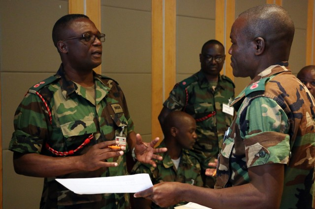 Officers of the Malawi Defence Force discuss support efforts August 9, 2016 in Lilongwe, Malawi as part of Southern Accord 2016's disaster relief tabletop exercise. SA16 is a U.S. Army Africa-led annual, combined military exercise that brings together U.S. military personnel with African partner nations to improve readiness, promote interoperability, build capacity and strengthen partner relationships. (U.S. Army photo by Staff Sgt. Candace Mundt/Released)