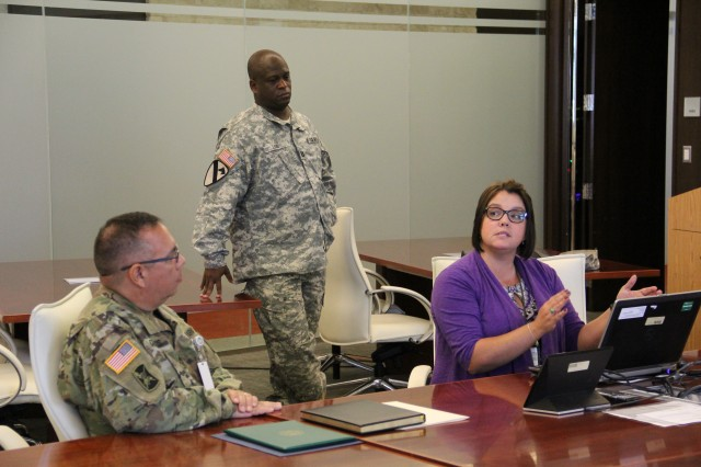 Career counselor at Aberdeen Proving Ground's Soldier for Life Program, Rebecca S. Price, directs the audience through the online social media platform LinkedIn during the U.S. Army Test and Evaluation Command's monthly Soldier for Life meeting at ATEC headquarters July 27.