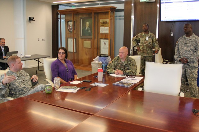 U.S. Army Test and Evaluation Command, or ATEC, employees have a group discussion on the online social media platform LinkedIn during ATEC's monthly Soldier for Life meeting at its headquarters building July 27.