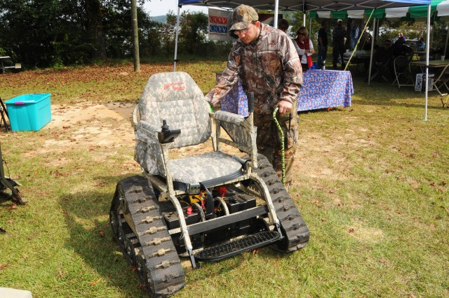 Then-Staff Sgt. Mark Brosel, checks out the track chair that he used throughout the hunt during the 2012 Wounded Warrior Fall Hunt. Fort Rucker maintains numerous pieces of equipment to help wounded warriors participate in hunting, fishing and camping activities.