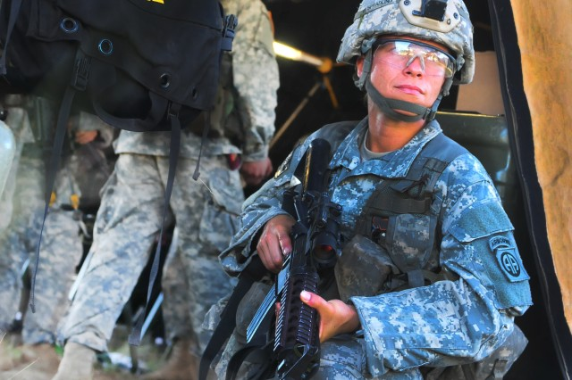 Spc. Esther Spradling, a Paratrooper assigned to 407th Brigade Support Battalion, 2nd Brigade Combat Team, 82nd Airborne Division, takes a defensive position outside of a medical center inside of the Brigade Support Area (BSA) Fort Bragg, North Carolina, Aug. 9, 2016. The 407th BSB's BSA provides logistics support for the brigade as they conduct a Combined Arms Live Fire Exercise in preparation for battalion-level live fire exercises later this year, keeping Paratroopers ready to jump, fight and win.
