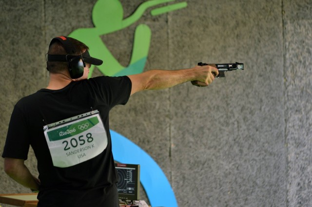 Sgt. 1st Class Keith Sanderson shoots rapid fire pistol in Rio Games