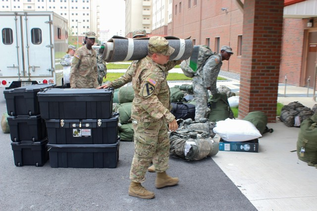 "Sgt. Jose Alvarado, HHC, 2nd Battalion, 8th Cavalry Regiment ""Stallions,"" 1st Armored Brigade Combat Team, 1st Cavalry Division, moves his belongings into the new barracks building July XX on US Army Garrison Humphreys, South Korea.  After the long convoy, Soldiers downloaded their equipment and brought their personnel stuff to their rooms. (US Army Photo by Spc. Jeremy Reuse, 2nd Battalion, 8th Cavalry Regiment, 1st Armored Brigade Combat Team, 1st Cav. Div.)"