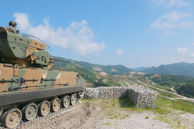 """Republic of Korea Army Soldiers operating a K30 Biho 'Flying Tiger,' a self-propelled anti-aircraft gun, provides anti-aircraft coverage Aug 3 at Nightmare Range, near Pocheon, South Korea. For a week, more than 140 US Army Soldiers from Company B, 2nd Battalion, 12th Cavalry Regiment, 1st Armored Brigade Combat Team, 1st Cavalry Division, and 493 Republic of Korea Army Soldiers from 137th Mechanized Battalion, 16th Mechanized Brigade, 8th Infantry """"Blitz"""" Division, conducted exercises, with the ROK Army leading the operations. (U.S. Army photo by Sgt. Christopher Dennis, 1st Armored Brigade Combat Team Public Affairs, 1st Cav. Div.)"""