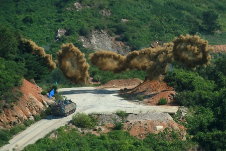 Smoke rings launched by a South Korean army K200 Infantry Fighting Vehicle burst over a training ground where South Korean and U.S. troops practiced working as a single force to assault an objective with ground troops supported by aircraft. The smoke helps hinder the enemy's view. The training ran July 30 through Aug. 4, at a training range near Pocheon and involved U.S. troops from Company B, 2nd Battalion, 12th Cavalry Regiment, part of the 1st Cavalry Division's 1st Armored Brigade Combat Team.