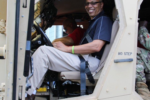 Maryland Lt. Gov. Boyd K. Rutherford smiles before he drives the Mine-Resistant Ambush Protected Vehicle All-Terrain Vehicle around the 4.5 mile Automotive Technology Evaluation Facility during his visit at Aberdeen Test Center Aug. 12.