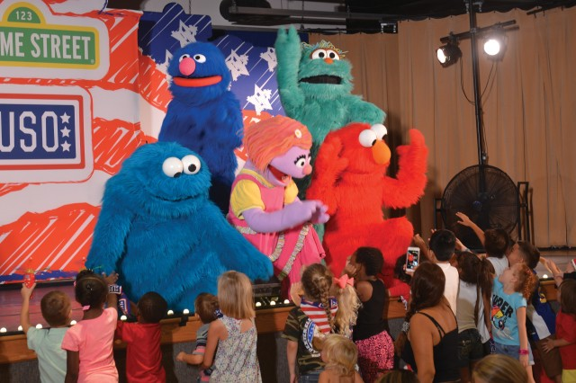 Children rush to the stage at the end of the Sesame Street/USO show Aug. 12 at the Sand Hill Recreation Center. #lifeisbetteratbenning