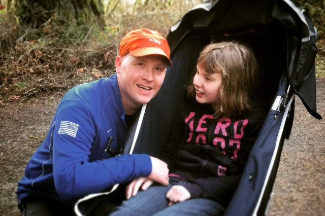 Maj. Mike Stinchfield with his daughter Ellyn, who is now 12.