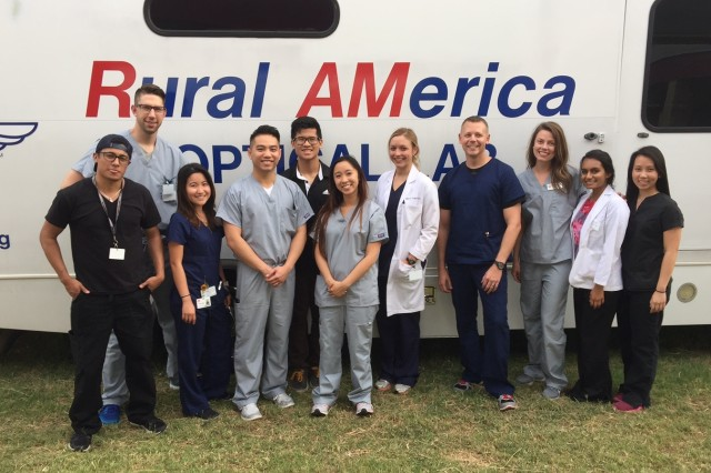 (From left) David Zarate, Seth Methvin, Thao Ngo, Tam Nguyen, Hoang Nguyen, Stacy Phuong, Dr. Allison Chinn, Army Maj. Brad Cunningham, Abby Wilmes, Anjli Patel, and Kim Chau, the optometry team who provided vision services to about 1,000 people in less than five days in the Rio Grande Valley.