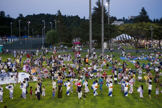 Several American and Japanese community members perform the traditional Bon dance during the 57th annual Bon Odori Festival at Camp Zama Aug. 6 attended by nearly 18,000 Japanese and American community members. (U.S. Army photo by Alia Naffouj)