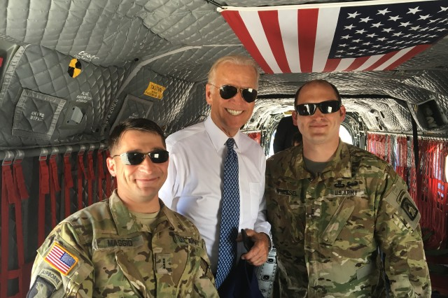 """Chief Warrant Officer 4 Michael Maggio, left, and Chief Warrant Officer 3 Gabe Whetsel, far right, assigned to the 12th Combat Aviation Brigade, pose for a picture with Vice President Joe Biden during his recent trip to Kosovo, Aug. 17, 2016.  Vice President Biden traveled to Kosovo to deliver remarks at the dedication ceremony of a road that is being named by the Government of Kosovo in honor of his son Joseph R. """"Beau"""" Biden, III."""