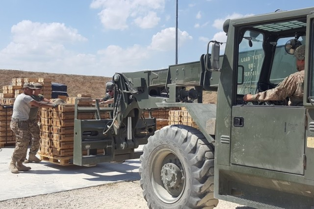 MIHAIL KOGALNICEANU, Romania -- Pvt. Efrain Nieves, an ammunition specialist assigned to the 23rd Ordnance Company, and native of Miami, FL, guides an Atlas 10000M Forklift into position July 12 here.