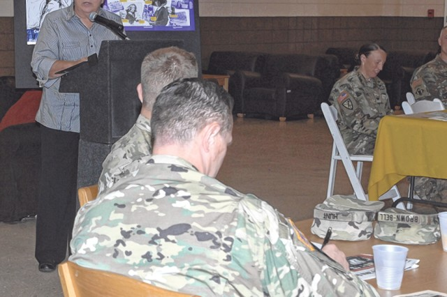 Waynesville Mayor Luge Hardman speaks about historic female figures during the Fort Leonard Wood Women's Equality Day Observance Tuesday at the Fort Leonard Wood USO facility.